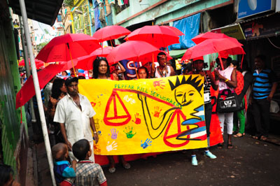 "march through streets of Kolkata carrying banner with slogan ""pepfar kills sex workers"""