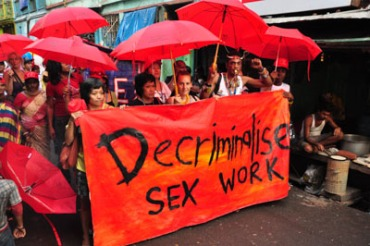 "march through streets of Kolkata carrying banner with slogan ""decriminalise sex work"""