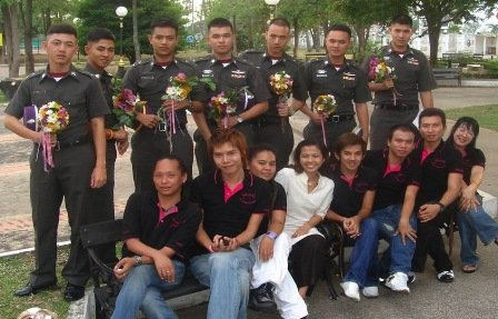 Outdoor group photo featuring Surang Janyam, SWING staff and Thai police cadets