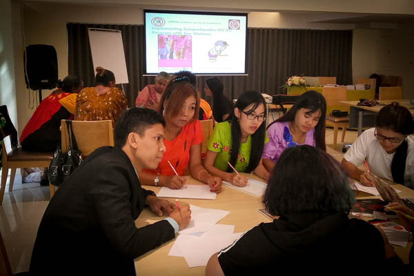 Participants work in small groups round a table at the APNSW Regional SWIT training, held in a hotel meeting room in Bangkok, April 2017